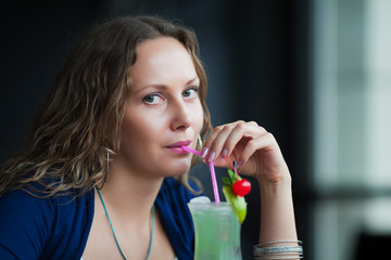 Young woman with a cocktail.