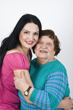 Happy grandmother and granddaughter embrace