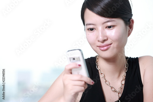 young asian business woman working with mobile phone