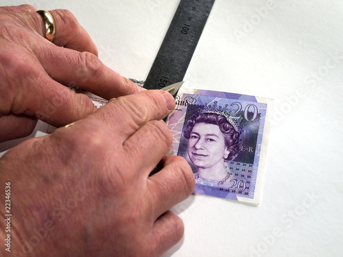 Twenty-pound note about to be cut