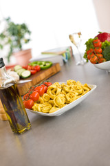 Cooking Italian food - pasta, tomato and olive oil