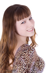 Red-hair girl in leopard dress posing over white