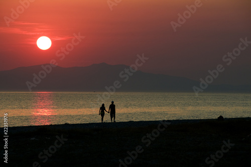 Couples walking at the agean sea coast of Turkey
