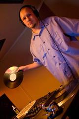 Hip-hop deejay holding a vinyl record