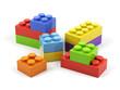 Plastic toy blocks on white background.