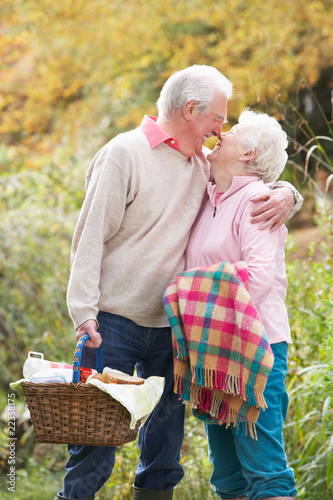 Romantic Senior Couple Outdoors With Picnic Basket By Autumn Woo