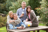 Group Of Friends Outdoors Enjoying Drink In Pub Garden poster
