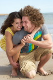 Affectionate Young Couple Having Fun On Beach poster