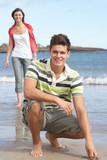 Affectionate Teenage Couple Having Fun On Beach poster