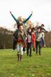 Group Of Teenage Friends Having Piggyback Rides In Autumn Landsc