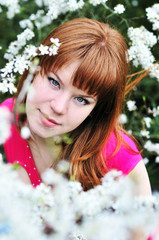redheaded girl in blossom