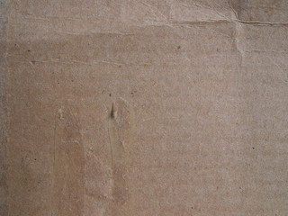 Section of cardboard texture with hardened glue