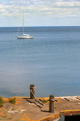 sail boat on lake superior with dock in foreground
