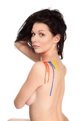Beautiful woman with color paint on her shoulder