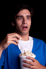 young man, with popcorn watching