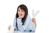 Happy young woman with coffee in pajamas poster