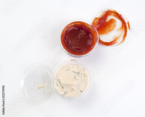 Ketchup and mayonnaise sauce on a white background