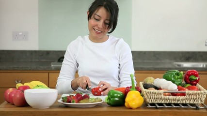 Woman making a salad