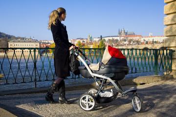 woman with a pram in Prague, Czech Republic