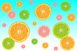 colorful slices of citrus fruits on a blue background