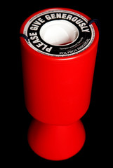 Red charity collection tin