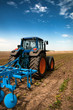 The Tractor - modern farm equipment in field
