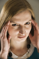 woman in migraine near