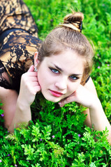 teen girl relaxing in the grass