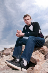 Young man on the rocks