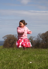 Smiling running toddler in a field