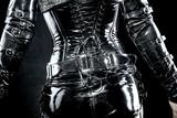 woman in black latex uniform poster