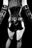 woman in black latex corset poster