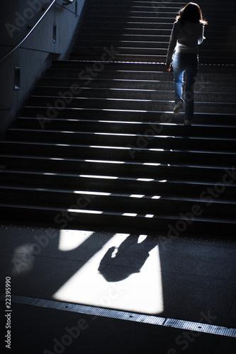 Girl going upstairs in subway