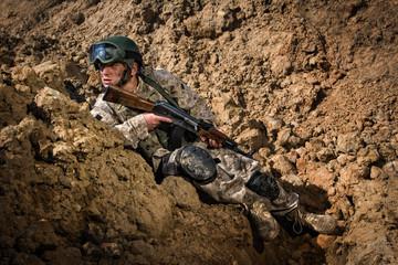 Soldier hiding behind rocks