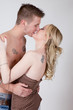 Lovers embrace with a passionate kiss