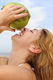 thirsty woman drinking coconut water, close-up poster