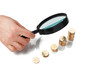 magnifier and golden coins