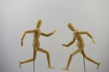 Two mannequins positioned into a hurrying posture