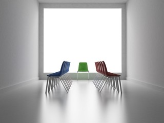 Two groups of colors chairs facing and one chair like a referee