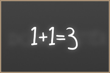 Chalkboard with text 1+1=3