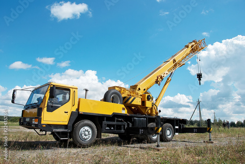 mobile crane with risen boom outdoors - 22435764