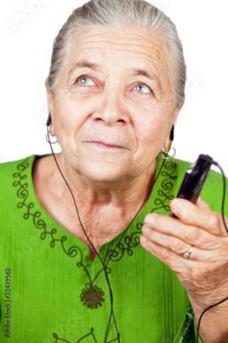 Senior woman listening music at mobile phone