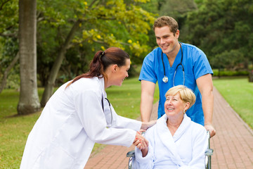 patient thanking young doctor