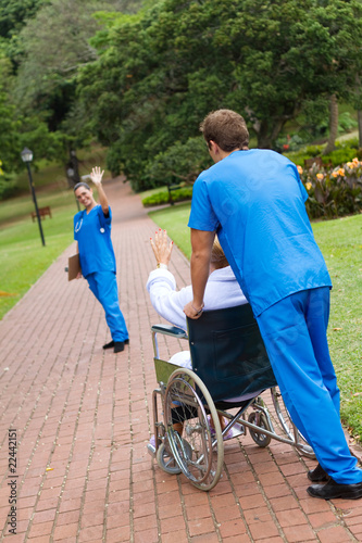 nurse waving goodbye to patient