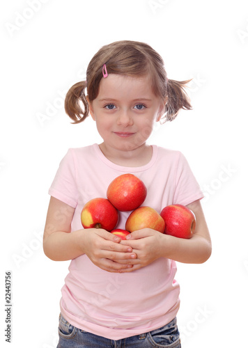 Little girl with red apples