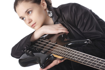 Beautiful girl with a bass guitar