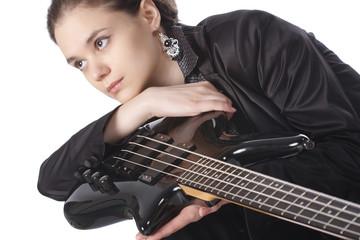 Beautiful girl with a bass guitar