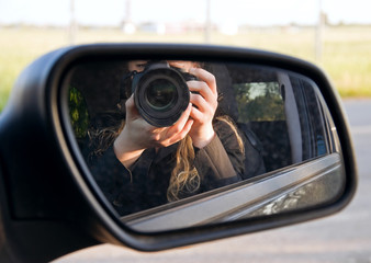 Driving mirror with photographer reflection.