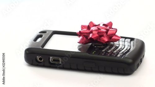 Cell phone topped with festive bow loop V2 - HD