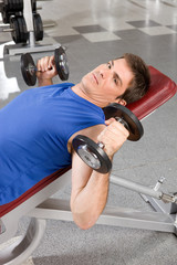 Close up of a man with dumbbells